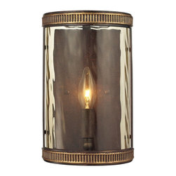 Elk Lighting - Mooreland 1-Light Sconce in Weathered Bronze - The Moorland Collection has a classic tuscan influenced design with a heavy iron frame, ribbed bandings with gold highlights, and subtly striated water glass. A weathered bronze finish is complemented by champagne glass for a warm ambiance.