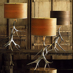 Aluminum Antler Lamp Bases With Wood Veneer Shades - These are a fun take on antler decor! The dramatic lamps add a masculine touch to a room but aren't afraid to shine. The faux bois shades are the perfect complements.