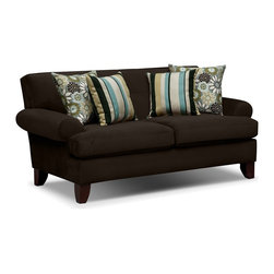 Madison Loveseat - Visual Appeal. Our Madison loveseat is as rich and inviting as its deep chocolate color. Presented with mid-century modern elements like thick tight-back cushioning and simple tufting, this loveseat's low roll arms and high wedge feet add current, casual appeal. The chocolate microsuede velvet fabric keeps the look clean and luxurious, while floral and striped toss pillows add a stimulating boost of style.