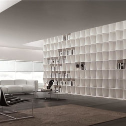 Wavy Bookshelf - Wavy is a bookcase system that rigorously combines design and function. It is a minimalistic product in which the thin structure and wavy design, both vertical and horizontal, gives the ensemble an image of great solidity and lightness. Contact info@casaspazio.com for more information.