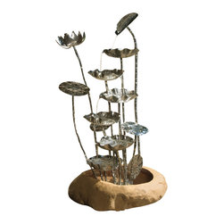 """Everybody's Ayurveda - Metal Lotus Fountain in Metal and Resin - Metal Lotus Fountain. Metal and Resin. 19"""" Wide x 15"""" Deep x 39"""" Tall. Transform your outdoor patio or favorite garden spot into an artful retreat with this unique, stylish Lotus Metal Water Fountain. This makes a beautiful, soothing accent piece. Distilled water is suggested for use."""