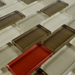 Glass Mosaic Tile - Product Description:Item#: COB0113Collection: Crystal Glass TileColor: Color Blend(Grey, Red and Black)Surface Finish: Glossy GlassShape: InterlockingChip Size: 1x2 In. (23mm x 48mm)Thickness: 5/16 In. (8mm)Each sheet of this glass tile is approximately 1 sq ft per sheet and is mesh mounted on high quality fiber glass for easy installation of your glass mosaic tile projects.Application: Glass mosaic tiles are impervious to the water, thus it is great for both interior and exterior use so moisture is not an issue. Mosaic glass tiles are great on floors and walls and have been most popular in bathrooms, spas, kitchen backsplash, wall facades and pools as well as a variety of other applications.Characteristics: Glass mosaic tile has a zero water absorption rate, and this tile exceeds ANSI standards for water absorption for mosaic tile. It is strong, durable, contamination free, and only the best quality tiles are selected as our tiles are inspected for blemishes before shipment.