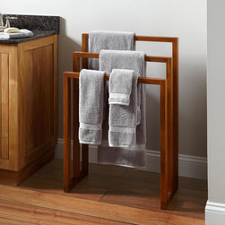 Hailey Teak Towel Rack - This honey-colored, three-tiered teak drying rack is simple and contemporary. And teak is the ideal material because it is water-resistant and resilient.