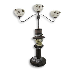 Zeckos - Steampunk Skeleton Candelabra Votive/Tealight Candle Holder - This steampunk inspired candelabra is a wonderful accent to tables in your home this Halloween Made of resin, it measures 15 1/2 inches tall, 12 inches wide, and has a 4 1/2 inch diameter base. It accommodates 3 votive or tea light candles up to 1 1/2 inches in diameter, try flickering LED candles for worry-free accent lighting that lasts all night. This candelabra makes a great centerpiece that is sure to be admired, year after year.