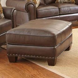 Steve Silver Furniture - Steve Silver Escher Ottoman in Coffee Bean Leather - The Escher ottoman adds style and comfort to any space. The ottoman is constructed using 100% leather with impressive Coffee Bean upholstery  accented by antique nailhead trim and solid wood accent legs.