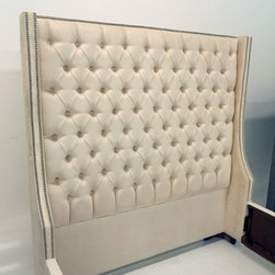 Grace Bed - The Grace Bed is shown upholstered in a Kravet Cream Velvet and finished with diamond tufting with a double nail head trim.