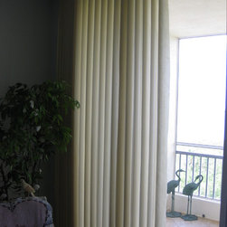 Illumasheers in Palmetto Condo - I did the same treatment in the master bedroom. Since the corner was difficult for my client to get to, this Illumasheer stacks on the left but the controls are on the right. My client loved that solution!