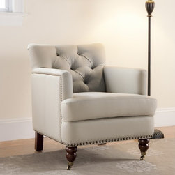 Safavieh - Colin Club Chair - Offering luxurious style and superb convenience, this Colin club chair features beautiful taupe upholstery with a tufted back and a comfortable seat. English caster feet allow for easy mobility, while stylish nailhead trim provides a timeless look.