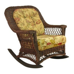 Spice Island Bar Harbor Wicker Rocker - Exuding elegance and a laid-back charm, the Spice Island Bar Harbor Rocker perfectly balances casual comfort with upscale tropical chic. A great addition to traditional or contemporary settings, it boasts a classic wicker/rattan weave with lattice design and braided trim detail in a choice of white or brown wash finishes. Plush cushions, along with the generous, comfy seat and supportive back, let you sink into luxurious comfort; while a selection of designer fabrics enhances any setting or color scheme. Featuring a sturdy wood-and-rattan frame, it sports a contoured back, gently sloping arms, and arched, lattice-patterned apron - all of which add to its enduring appeal. Whether it's your living area or sunroom, this rocker is sure to be the one place you make a beeline for when you return home at the end of a busy day.Additional Information:Seat height: 22 inches1-year manufacturer's warranty for residential useRecommended use: This arm chair is not designed for outdoor use. It is constructed of natural materials and will not withstand the elements. It's for indoor or sunroom use only.Please note: The cushion fabric shown in the picture may not be available.About Yesteryear WickerFrom small beginnings in 1987, Yesteryear Wicker now produces some of the highest quality wicker furniture in the world. The company began when founder Don Walker transformed his hobby of collecting antique wicker furniture into a thriving business. The company prides itself on keeping an American furniture tradition alive while honoring the skilled handicraft of the original Irish immigrants of yesteryear.