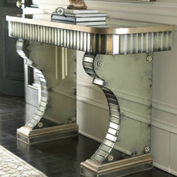 Stella Mirrored Console - The shape of the legs on this console table is unique, and they're still sturdy.