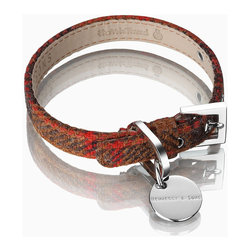 Frontgate - Harris Tweed Dog Collar - Buckle and tag are rendered in high-quality and antiallergenic 316L surgical stainless steel to guarantee durability. Packed in a cotton pouch and gift box. Our authentic Harris Tweed Dog Collar is handwoven in the ages-old tradition by Scottish islanders, using pure virgin wool that has been dyed and spun in the Outer Hedbrides, then lined with antiallergenic French Alsavel leather. The collar offers classic comfort and style for your favorite pooch. .  . Imported. To determine the correct size, place a soft measuring tape around your dog's neck with an allowance for two fingers to fit between the dog and collar. The measurement should fall between the first and last numbers of our corresponding size.