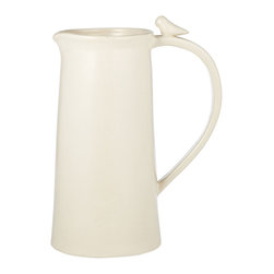 Bird on Pitcher - Whimsically simple, the Bird on Pitcher has a charmingly subtle silhouette with a sweet avian visitor perched on the open arch of its plain handle. Straight walls in clean white ceramic lead the eye upward from a round base to this tiny, unusual detail, making the pitcher a perfect springtime accent for the breakfast table and a superb windowsill vase for greenery bouquets.