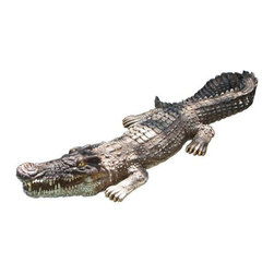 Poolmaster - Crocodile Body Float - The lifelike crocodile body foat by poolmaster is a great decor item for your garden deck pond pool or spa. It feels real to the touch and is constructed with durable materials to last.