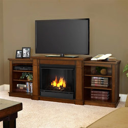 """Real Flame - Hawthorne Gel Fireplace in Burnished Oak - Includes: Mantel, firebox, hand painted cast concrete log, and screen kit. Shelf dimensions:18.25""""W X 15.25""""D. Fits up to a 50""""(diagonal) TV, 100 lb. weight limit. Uses clean burning Real Flame Gel fuel emitting up to 9,000 BTUs of heat per hour lasting up to 3 hours. Solid wood and veneered MDF construction. Uses Only Real Flame 13oz Gel Fuel Cans, not included. Assembly Required. 74.72 in. W x 18.82 in. D x 29.88 in. H (138 lbs.)The Hawthorne Gel Fireplace features mission inspired details, arched side panels, a multi level top surface and room for media and A/V component storage; doubling it's use as an entertainment unit. Supports most TV's weighing 100 lbs. or less. The hand-painted log set and bright crackling flame add to the realistic look of this Real Flame Gel Fuel Fireplace. Uses 3-13oz cans of Real Flame Gel Fuel."""