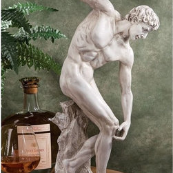 Design Toscano - Design Toscano 19 in. Discobolos Sculpture (c. 450 B.C.) - EU4394 - Shop for Sculptures Statues and Figurines from Hayneedle.com! A perfect example of the classic discus thrower the Design Toscano 19 in. Discobolos Sculpture (c. 450 B.C.) is an ancient replica cast in designer resin and finished to resemble antique stone. A study in movement perfect for your home collection.About Design ToscanoDesign Toscano is the country's premier source for statues and other historical and antique replicas which are available through the company's catalog and website. Design Toscano's founders Michael and Marilyn Stopka created Design Toscano in 1990. While on a trip to Paris the Stopkas first saw the marvelous carvings of gargoyles and water spouts at the Notre Dame Cathedral. Inspired by the beauty and mystery of these pieces they decided to introduce the world of medieval gargoyles to America in 1993. On a later trip to Albi France the Stopkas had the pleasure of being exposed to the world of Jacquard tapestries that they added quickly to the growing catalog. Since then the company's product line has grown to include Egyptian Medieval and other period pieces that are now among the current favorites of Design Toscano customers along with an extensive collection of garden fountains statuary authentic canvas replicas of oil painting masterpieces and other antique art reproductions. At Design Toscano attention to detail is important. Travel directly to the source for all historical replicas ensures brilliant design.