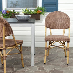 Safavieh - Safavieh Barrow Stackable Dining Side Chair - Set of 2 - FOX5203A-SET2 - Shop for Chairs and Sofas from Hayneedle.com! With the Safavieh Barrow Stackable Dining Side Chair - Set of 2 all that's missing from your backyard Havana haven is maybe a smooth cigar and a tall Cuba Libre. Even if smoking and drinking aren't really your thing turning your backyard into a tropical getaway with these comfortable side chairs certainly could be. The combination of bamboo-style frame and wicker wrap produces a distinctly equatorial appearance. However the aluminum and PE wicker construction guarantee a longer life based on superior materials able to stand up to the elements.About SafaviehConsidered the authority on fine quality craftsmanship and style since their inception in 1914 Safavieh is most successful in the home furnishings industry thanks to their talent for combining high tech with high touch. For four generations the family behind the Safavieh brand has dedicated its talents and resources to providing uncompromising quality. They hold the durability beauty and artistry of their handmade rugs well-crafted furniture and decorative accents in the highest regard. That's why they focus their efforts on developing the highest quality products to suit the broadest range of budgets. Their mission is perpetuate the interior furnishings craft and lead with innovation while preserving centuries-old traditions in categories from antique reproductions to fashion-forward contemporary trends.