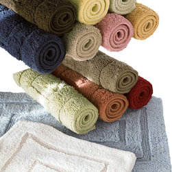 Luxor Linens - Bliss Luxury Bath Rug - When you have to step out of your soothing bath, you want to step onto something equally cozy. These deliciously soft bath rugs are made from the same Egyptian cotton as Luxor's luxury towel sets, and will help extend the spa-like luxury throughout your bathroom. They come in two sizes and 12 juicy colors — and you can even get matching towels to complete the look.