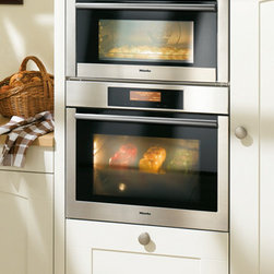 Miele Speed Oven - The Miele Speed Oven is built for those wanna-be gourmet chefs who just don't have the free hours to invest in broiling, baking, or basting their dream meals. This high-functioning oven is alos a 1,000 watt microwave — for those nights when there's only time for leftovers.