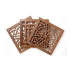Jali Designs high-quality hand-carved walnut trays, tray table and trivets - Wooden 'jali' (lattice) screens are traditionally found instead of windows on the old houses in Afghanistan, preserving privacy and sheltering inhabitants from the strong sunshine. Small pieces of cedar or walnut wood are fitted together by hand, traditionally without glue, into intricate geometric patterns.