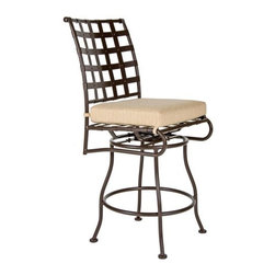 O.W. Lee Classico Wrought Iron Swivel Barstool - You'll love sitting outside during the warm summer months enjoying a cold drink and good company while sitting comfortably in the O.W. Lee Classico Swivel Barstool. Handcrafted from wrought iron, this swivel barstool features gorgeous and rich Old World craftsmanship and a classic design that complements any decor. Designed to bring comfort, style, and tranquility to your patio, you'll love looking at this chair as much as you love sitting in it. The Classico Swivel Barstool comes with your choice of Sunbrella cushion so you can accent your existing patio furniture as well as display your own taste and style. Sunbrella cushions are fade-, stain-, mildew-, and water-resistant, easy to clean with mild soap and water, and come with a five year warranty. You friends and family will enjoy coming over to your house to enjoy food and drinks outdoors, playing games, talking, and just spending time together. The Classico Swivel Barstool gives you just one more reason to invite people over whenever it's warm outside. Please note: This item is not intended for commercial use. Warranty applies to residential use only.Please note: This piece will be delivered with White Glove service which includes location placement. Unpacking and assembling the item will be left to the customer. Due to the custom-made nature of this item, orders usually ship within approximately 5 weeks. Because each item is assembled just for you, orders cannot be cancelled. A 50% restocking fee will apply for returns.This item is custom-made to order, which means production begins immediately upon receipt of each order. Because of this, cancellations must be made via telephone to 1-800-351-5699 within 24 hours of order placement. Emails are currently not acceptable forms of cancellation. Thank you in advance for your consideration in this matter.Materials and construction:Only the highest quality materials are used in the production of O.W. Lee Company's furniture. Carbon steel, galvanized steel, and 6061 alloy aluminum is meticulously chosen for superior strength as well as rust and corrosion resistance. All materials are individually measured and precision cut to ensure a smooth, and accurate fit. Steel and aluminum pieces are bent into perfect shapes, then hand-forged with a hammer and anvil, a process unchanged since blacksmiths in the middle ages.For the optimum strength of each piece, a full-circumference weld is applied wherever metal components intersect. This type of weld works to eliminate the possibility of moisture making its way into tube interiors or in a crevasse. The full-circumference weld guards against rust and corrosion. Finally, all welds are ground and sanded to create a seamless transition from one component to another.Each frame is blasted with tiny steel particles to remove dirt and oil from the manufacturing process, which is then followed by a 5-step wash and chemical treatment, resulting in the best possible surface for the final finish. A hand-applied zinc-rich epoxy primer is used to create a protective undercoat against oxidation. This prohibits rust from spreading and helps protect the final finish. Finally, a durable polyurethane top coating is hand-applied, and oven-cured to ensure a long lasting finish.About SunbrellaSunbrella has been the leader in performance fabrics for over 45 years. Impeccable quality, sophisticated styling and best-in-class warranties prove the new generation of Sunbrella offers more possibilities than ever. Sunbrella fabrics are breathable and water-repellant. If kept dry, they will not support the growth of mildew as natural fibers will. Beautiful and durable, Sunbrella is a name you can trust in your outdoor furniture.About O.W. Lee CompanyAn American family tradition, O.W. Lee Company has been dedicated to the design and production of fine, handcrafted casual furniture for over 60 years. From their manufacturing facility in Ontario, California, the O.W. Lee artisans combine centuries-old techniques with state-of-the-art equipment to produce beautiful casual furniture. What started in 1947 as a wrought-iron gate manufacturer for the luxurious estates of Southern California has evolved, three generations later, into a well-known and reputable manufacturer in the ever-growing casual furniture industry.