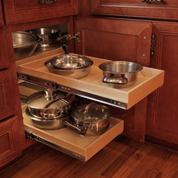 Blind Corner Cabinet Solution - ShelfGenie of Indiana has a solution to make better use of your corner cabinet space.  Our blind corner solution is a system of pull out shelves.  Extend the front shelf completely forward and you are now able to slide the shelf from the corner position over, making the corner items much more easily accessible.