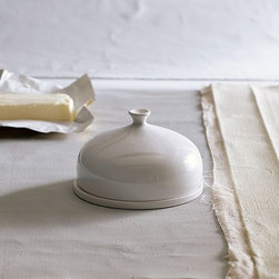 New Bell Butter Dish - In the dome. Perfectly proportioned to fit rectangular European-style blocks of butter as well as slender stateside sticks, this round covered dish looks elegant and keeps butter cool on counters and tabletops.