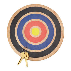 Modern Beech Wood Key Target Magnet - For those long days when even hanging up your keys requires too much exertion, this innovative design turns homecoming into target practice. Designed by Danny Giannella and Tammer Hijazi, this decorative beech wood key holder offers strong magnets to hold your keys--so all you have to do is toss at the target, and know they'll stay there when you need them the next morning. Now if only magnets could remove our shoes and prepare dinner for us. Round metal keyring included