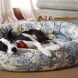Divine Donut Pet Bed - Your pet will love nestling into the secure comfort of the cozy oval outer ring and removable tufted cushion filled with high-loft, polyester memory fiber. Elegantly upholstered with durable, furniture-quality microvelvet or cotton twill. Bedcover is removable and machine washable.