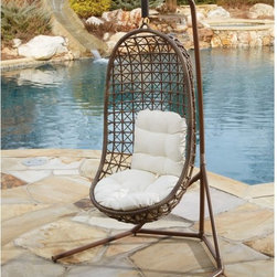 Panama Jack - Panama Jack Island Cove Open Weave Hanging Chair with Base Multicolor - PJO-8001 - Shop for Hammocks from Hayneedle.com! You can't beat the gentle motion of the Panama Jack Island Cove Open Weave Hanging Chair with Base when it's time to get some fresh air and kick back outdoors. The body of the chair is crafted from extruded tubular aluminum for a robust and lightweight frame. It's wrapped in Viro Panama Jack's proprietary synthetic material that has the look and feel of authentic wicker without being susceptible to moisture rot or cracking. The base is also formed from thick-walled aluminum tubing with a powder-coat finish that will inhibit rusting and corrosion. Thick cushions add extra comfort to this already luxurious and eye-catching chair.About Hospitality RattanHospitality Rattan has been a leading manufacturer and distributor of contract quality rattan wicker and bamboo furnishings since 2000. The company's product lines have become dominant in the Casual Rattan Wicker and Outdoor Markets because of their quality construction variety and attractive design. Designed for buyers who appreciate upscale furniture with a tropical feel Hospitality Rattan offers a range of indoor and outdoor collections featuring all-aluminum frames woven with Viro or Rehau synthetic wicker fiber that will not fade or crack when subjected to the elements. Hospitality Rattan furniture is manufactured to hospitality specifications and quality standards which exceed the standards for residential use.Hospitality Rattan's Environmental Commitment Hospitality Rattan is continually looking for ways to limit their impact on the environment and is always trying to use the most environmentally friendly manufacturing techniques and materials possible. The company manufactures the highest quality furniture following sound and responsible environmental policies with minimal impact on natural resources. Hospitality Rattan is also committed to achieving environmental best practices 