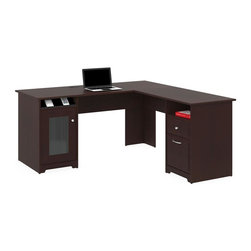Bush - L-Shape Desk in Harvest Cherry Finish - Sleekly designed lines. Open storage space. Distinctive fluted glass panel door. Rugged and tough surface. Easily accessible. Integrated four port USB hub. Charging station. Tall storage compartment. Stylish fluted glass door. One box drawer. Single file drawer. Fully extendable ball-bearing slides. Attractive and nickel-plated metal drawer pulls. Wipe clean. Warranty: One year. Made from particleboard and laminates. 59.45 in. W x 59.45 in. D x 30.16 in. H (143 lbs.)Take executive sophistication to an elegant business level. Spread out in all directions with the Bush Furniture Harvest Cherry Cabot Collection 60 in. L-Desk. Inspired by sleekly designed lines and polished appointments, the L-Desk s rich Harvest Cherry finish fits with contemporary or antique furnishings at home or at the office. Accommodates letter- legal-or A4-sized files. Charging station keeps cameras, tablets and phones powered up but at your fingertips, reducing desktop clutter.