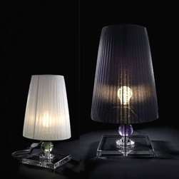 """Modiss - Modiss Julia table lamp - The Julia table lamp from Modiss has been designed by Alfonso Fontal in 2007. This table mounted luminaire is great for incandescent lighting. The Julia is composed of a gauze fabric shade with a carved transparent crystal base. The shade is available in black or white. The crystal ball that is located in the center of the stem of the base is available in lime green or tinted grey.  Product Details: The Julia table lamp from Modiss has been designed by Alfonso Fontal in 2007. This table mounted luminaire is great for incandescent lighting. The Julia is composed of a gauze fabric shade with a carved transparent crystal base. The shade is available in black or white. The crystal ball that is located in the center of the stem of the base is available in lime green or tinted grey. Details:                                      Manufacturer:                                      Modiss                                                     Designer:                                     Alfonso Fontal                                                     Made in:                                     Spain                                                     Dimensions:                                      Small: Height: 7.5"""" (19 cm) Diameter: 14.2"""" (36 cm)                          Large: Height: 18.9"""" (48 cm) Diameter: 11"""" (28 cm)                                                                                                       Light bulb:                                      Small: 1 X 40W incandescent                          Large: 1 X 60W incandescent                                                                                                       Material:                                      Methacrylate, Crystal, Gauze Fabric"""