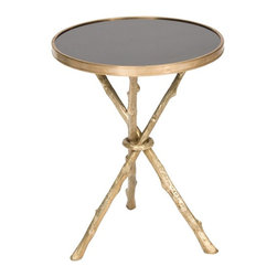 Twig Table - I have spied similar tables to this in some of my very favorite Houzz photos, and I was so glad to find this brass and black granite version of a twig table. It adds instant glam to any room.
