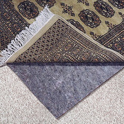 """No-Muv Rug Pad for Rugs on Carpeting - This No-Muv™ brand rug pad is a stiff fiber, felt-like pad that is designed to provide a non-moving and firm surface for large rugs on top of carpeting. With this premium rug pad there will be no """"creeping"""" or rumpling of the rug as it's walked on, keeping it flat and firmly in position. (Note: If you have a rug smaller than 6 x 9, we usually recommend the Teebaud pad.)"""