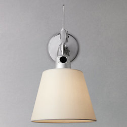 Artemide Tolomeo Wall Lamp - Artemide Tolomeo Wall Shade Lamp from Stardust.  This simple, yet stylish, wall light is perfect for adding a timeless look to your interior. Finished in a polish aluminium, it's crisp and clean. The arm has an articulation that enables the diffuser to rotate around 30° perpendicular to the wall, perfect for directing the light where you need it.   Artemide is an Italian lighting company established in 1960. Artemide's models appear in the collections of some of the word's most prestigious museums of art and design including MoMA and the V&A.