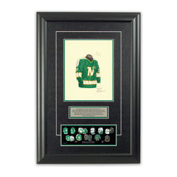 """Heritage Sports Art - Original art of the NHL 1968-69 Dallas Stars jersey - This beautifully framed piece features an original piece of watercolor artwork glass-framed in an attractive two inch wide black resin frame with a double mat. The outer dimensions of the framed piece are approximately 17"""" wide x 24.5"""" high, although the exact size will vary according to the size of the original piece of art. At the core of the framed piece is the actual piece of original artwork as painted by the artist on textured 100% rag, water-marked watercolor paper. In many cases the original artwork has handwritten notes in pencil from the artist. Simply put, this is beautiful, one-of-a-kind artwork. The outer mat is a rich textured black acid-free mat with a decorative inset white v-groove, while the inner mat is a complimentary colored acid-free mat reflecting one of the team's primary colors. The image of this framed piece shows the mat color that we use (Hunter Green). Beneath the artwork is a silver plate with black text describing the original artwork. The text for this piece will read: This original, one-of-a-kind watercolor painting of the 1968-69 Minnesota North Stars (now Dallas Stars) jersey is the original artwork that was used in the creation of this Dallas Stars uniform evolution print and tens of thousands of other Dallas Stars products that have been sold across North America. This original piece of art was painted by artist Nola McConnan for Maple Leaf Productions Ltd. Beneath the silver plate is a 3"""" x 9"""" reproduction of a well known, best-selling print that celebrates the history of the team. The print beautifully illustrates the chronological evolution of the team's uniform and shows you how the original art was used in the creation of this print. If you look closely, you will see that the print features the actual artwork being offered for sale. The piece is framed with an extremely high quality framing glass. We have used this glass style for many years with exc"""