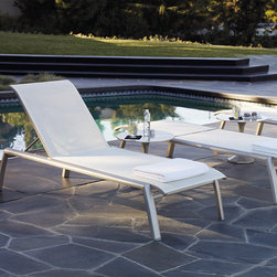 Frontgate - Set of Two Momentum Outdoor Chaise Lounges, Patio Furniture - Champagne frame with pearl white mesh. Easily relocates on back yards and promenade decks. 7 position back. Steel-reinforced aluminum frame resists corrosion. Quick-drying, flexible mesh sling. The sophisticated Momentum Chaise is a finely finessed canvas of comfort—from the sleek contract-grade aluminum frame to its seamless, nonclinging mesh. The flexible mesh sling gently supports your entire body, and will stand the test of time and weight. .  .  .  .  . Stacks for storage .