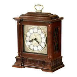 "Howard Miller - Howard Miller - Akron Mantel Clock - Don�۪t let time slip away. Portable brass handles carry this great deep wood and golden accentuated selection. perfectly positioned circles frame the hour with iron cast intricately detailed hands to point out the time. Framed with great dark wood, tradition and sophistication exudes from this selection. * This bracket style clock is embellished with stylish details from top to bottom. . A brass handle, reeded columns with turned caps, and a matching reeded base frame the decorative dial. . The brushed nickel dial is enhanced with an applied brass-toned, etched fret center disk and corner ornaments. A raised brass-toned bezel, silver numeral ring with black floral pattern, . applied brass numerals, and serpentine hands provide additional flourishes. . Gracefully styled fret panels add interest to the clock's sides. . Finished in Windsor Cherry on select hardwoods and veneers. . Quartz, dual chime movement plays Westminster or Ave Maria chimes, and features volume control and automatic nighttime chime shut-off option. . H. 16-1/2"" (42 cm). W. 12"" (31 cm). D. 7"" (18 cm)"