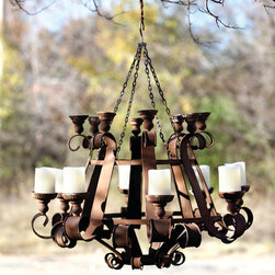 Rusty Grand Chandelier - Two feet of rusty metal curlicues and flourishes. Two levels and sizes of candle cups to adjust the drama. Hangs from a chain to render it mobile. Would be breathtaking for a special dinner on the lawn.
