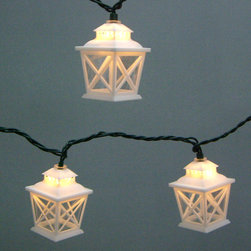 Garden Treasures White Mini Bulb Crisscross Lantern Patio String Lights - These mini white lanterns have a classic flair and remind me of Nantucket vacations. They come in black as well, which would be equally classic, and great for a Halloween party.