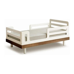 """Oeuf Nursery Cribs and Furniture - Oeuf Classic Walnut Toddler Bed - Ready for a big kid bed, sort of? The Oeuf Walnut Toddler Bed is the perfect """"in between"""" solution for those """"in between"""" years. Built in stylish safety rails keep you sleeping soundly knowing your little one won't fall out. The Oeuf toddler bed is also close to the ground, making it easy for them to hop in all by themselves. Simply use the same mattress from their crib! Can be used for years, easily up to 6+ years of age."""