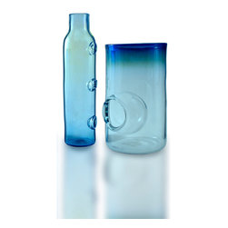 Esque - Bubble Vase - Put this handmade glass vase anywhere you need some color, shine, functionality and overall drama. At about 14 inches high, the blown blue glass features a popped bubble on the side and darker blue rim around the top. It will look great in rooms from contemporary to coastal to eclectic.