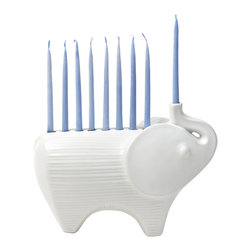 """Jonathan Adler - Jonathan Adler Ceramic Elephant Menorah - A mod take on a classic Hanukkah accent, the Jonathan Adler Elephant menorah radiates holiday glamour. This stoneware candle holder delights with a curved white animal-inspired silhouette. High-fired stoneware with a matte white glaze; 10""""W x 4""""D x 6.75""""H; Holds nine tapered candles"""