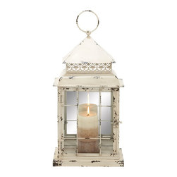 Metal Glass Lantern with Antique Styled Design - Create a peaceful atmosphere in your house or office by lighting this stylish lantern. This amazing lantern is ideal for your any part of your living space. A metal finish completely changes the look of your decor and adds a classic antique touch. You can simply place a candle inside the lantern and set the mood right for a perfect evening with your partner. This easy to maintain lantern will instantly light up the dull and boring ambience of any place. You can also gift it to a dear one. The lantern is made from metal and glass that reflects maximum light through it brightening up your decor. Its metallic layering will keep the glass intact and durable.. It comes with following dimensions