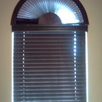 Blinds, shades and shutters - Custom sunburst arch top in faux wood matches the faux wood blind below perfectly.