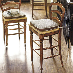 Ballard Designs - Avignon Barstool - We can't decide which we like better, the classic styling or the great value. Crafted of solid birch, our Avignon Stools have the warm, honey tones and carved details that define true French Provincial furniture. Stools have wide comfortable rush seats and echo the Collection's signature scalloped detail. Coordinates with Ballard Essential Cushion FC125 and Suzanne Kasler Signature Cushion FC351.