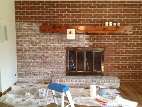 my house had a large wall of red brick with fireplace in living room ...