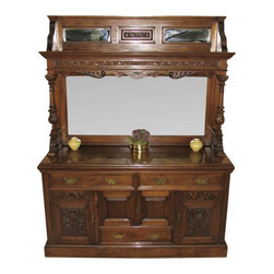 Antiques - Antique Rare Victorian Walnut Beveled Edge Mirror Sideboard Server Buffet - Country of Origin: England. Circa 1890. Victorian Period. Antique Walnut Finish. Solid Wood Construction. Two Ornately Carved Columns. Original Brass Hardware. Lots of Storage Shelves and Drawers. Three Beveled Edge Mirrors. Excellent Condition. This is a stunning antique Victorian walnut sideboard server buffet with a large beveled edge mirror and two uniquely placed beveled edge mirrors at the top from circa 1890. There are two large drawers and one smaller one on the lower half of the buffet. The left hand side cabinet door has 2 shelves, the middle cabinet door has one large compartment and the right hand cabinet door has a shelf and a metal clad wooden box. This metal clad wooden box was used to chill wine. Two ornately carved columns flank this buffet to either side and support the crown. There is additional storage space on top of the crown in front of the two mirrors. There is a small piece of trim missing at the bottom of the left hand side column to the front and the rear as shown in the picture. The hardware appears to be original and is made from brass. This majestic piece won't last long. Take advantage today.