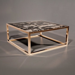 Petrified Wood Coffee Table - This is an impossibly cool coffee table from Hudson. It's totally carbon-dated chic!