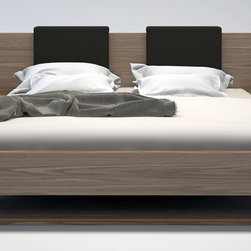 """Zuri Furniture - Viserys King Platform Wooden Bed - Walnut - The Viserys platform bed is perfect for creating a look of Zen in your bedroom retreat. Both sleek and warm, the Viserys features an extended wood-finished headboard overlapping two """"floating"""" single-drawer nightstands which are seamlessly attached to the bed frame. Flexible wood slats sit inside the bed frame and allow air to circulate beneath the mattress. No box spring necessary. Mattress sits 5"""" inside frame. Includes two L-shape backrest pillows in white eco leather. Platform height measures 14 inches (5 inch inset). Available in California-King, Standard King, and Queen sizes. Available in wenge or walnut wood finishes. Assembly required. Mattress not included. Imported.PRODUCT DETAILS:- King: W 127"""" x D 86"""" x H 33""""; H 14"""" platform- Queen: W 111"""" x D 86"""" x H 33""""; H 14"""" platform- Natural Wood Veneer in Walnut or Wenge Finish- Includes 2 Attached Single Drawer Nightstands & Backrest Pillows- Pine Wood Slats"""