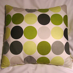 Throw Pillow Cushion Cover in Lime Green from Chez Lélé - Polka dots are fun and fresh! One of these on a sofa would add some visual punch.